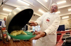 Howard Helmer cooking an omelette