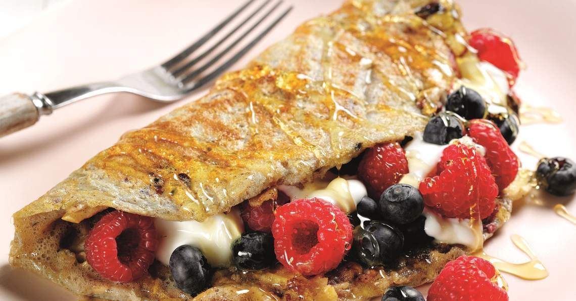 Muesli and berry egg wrap
