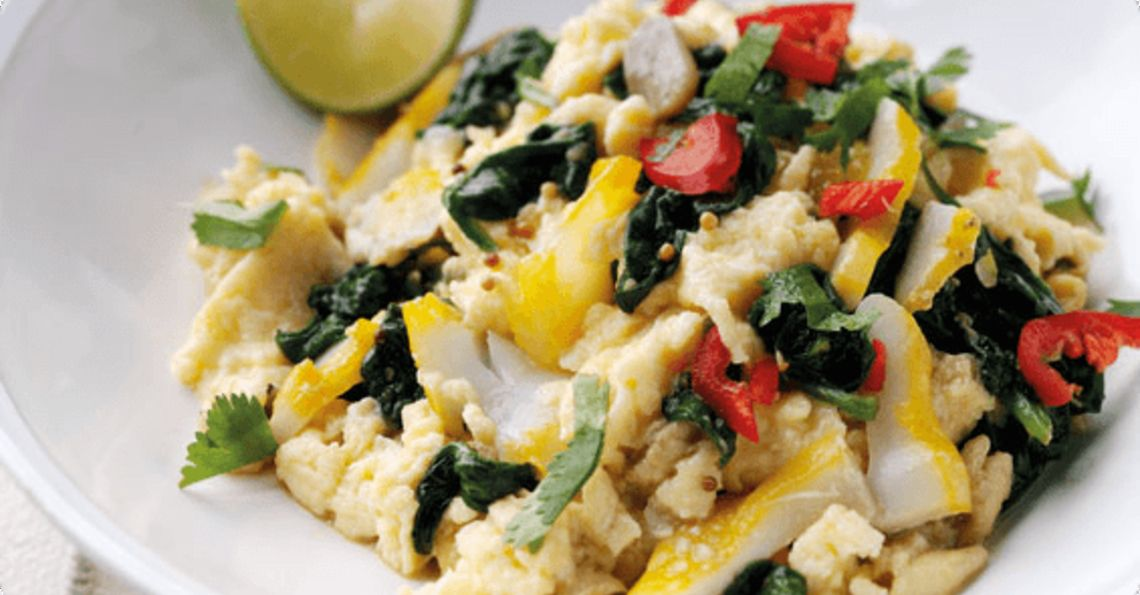 Curried scrambled eggs with spinach and smoked haddock