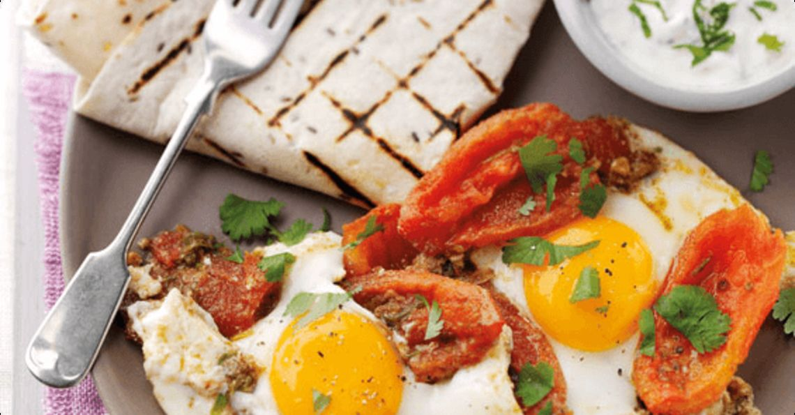 Moroccan spiced eggs and tomatoes with a minted yoghurt