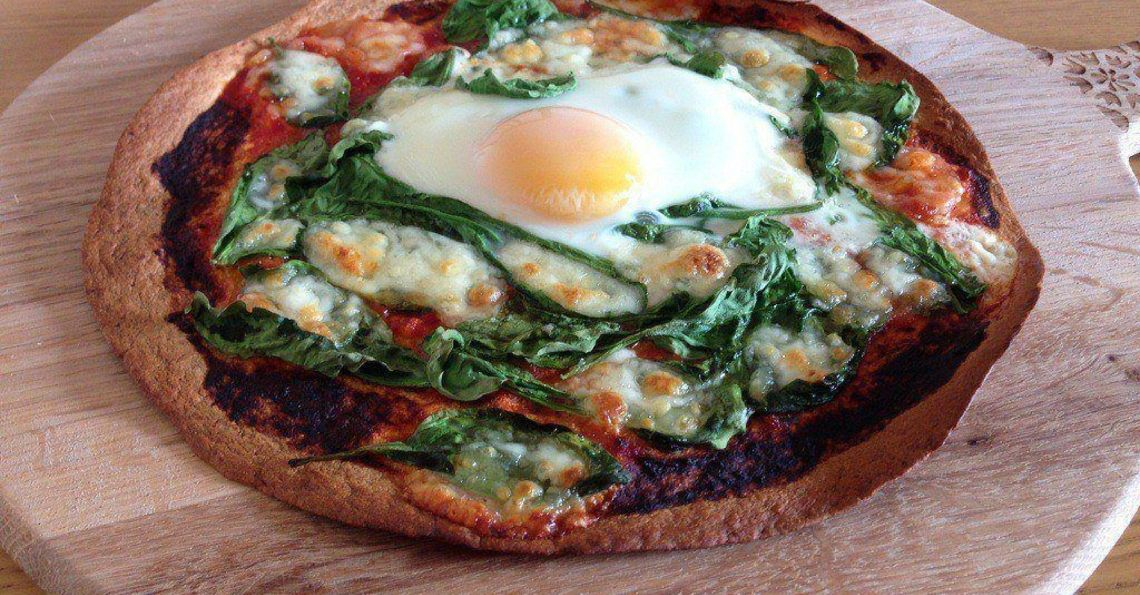Spinach and egg tortilla pizza