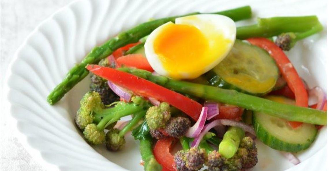 Soft boiled egg and seasonal vegetable salad