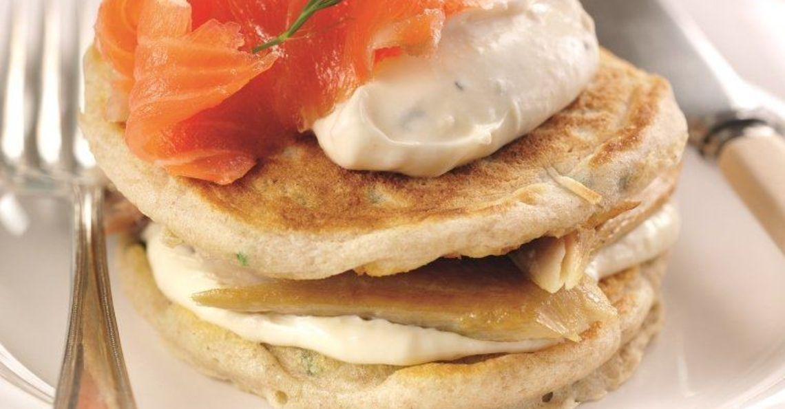 Giant Russian blinis with horseradish, mackerel and salmon topping