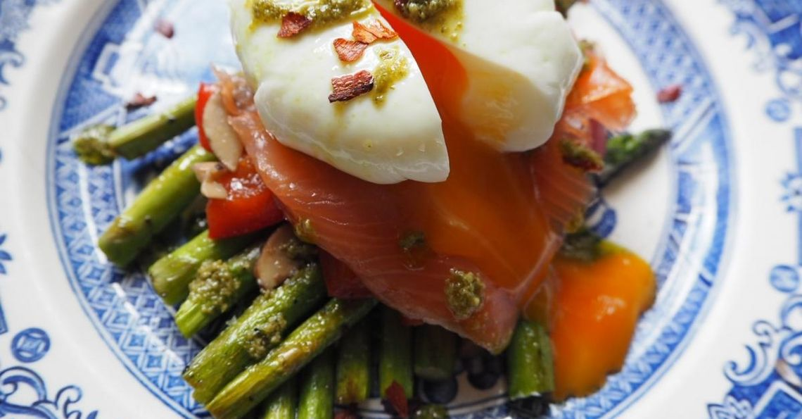 Eggs, asparagus & salmon stack with a pesto drizzle