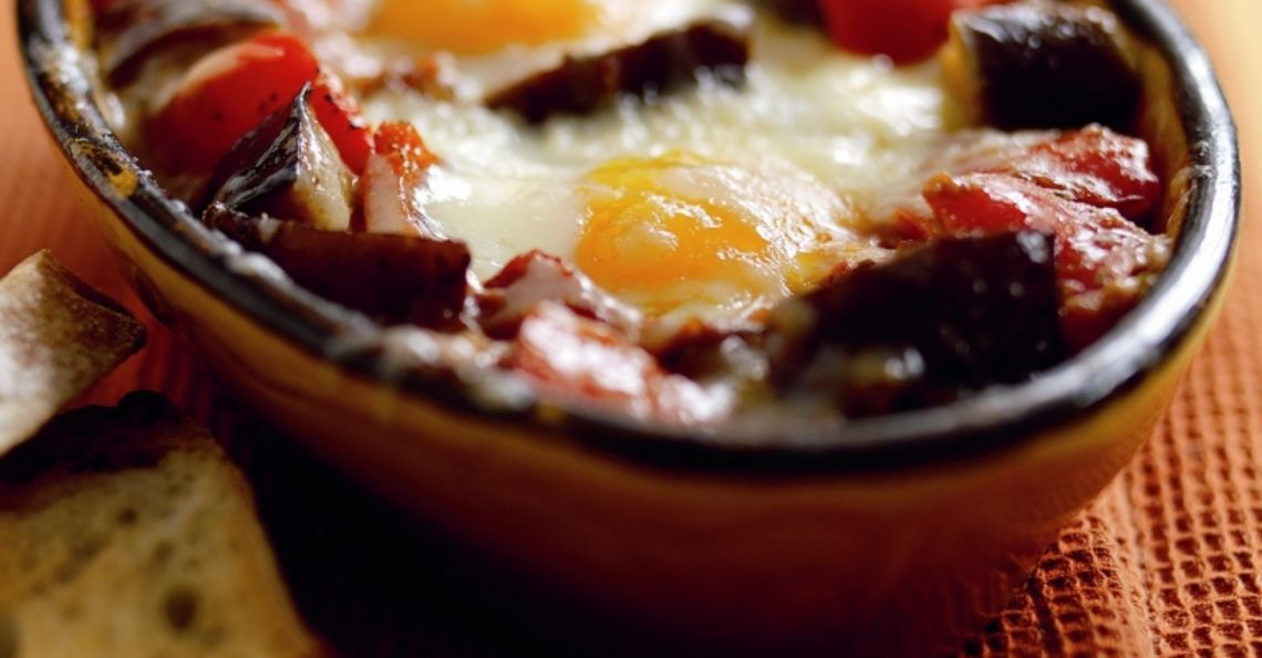 Aubergine and tomato baked eggs