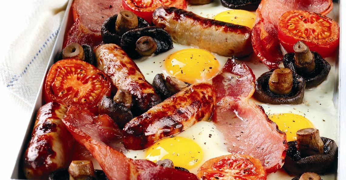 Baked breakfast with tomato and mushroom