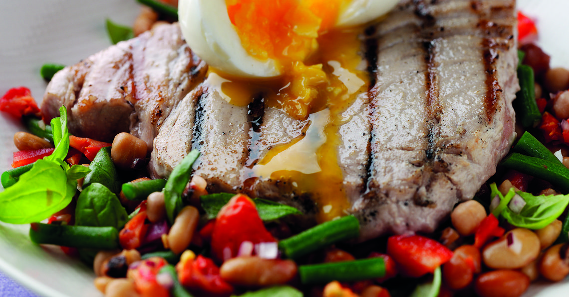 Seared tuna steak with three-bean salad and a soft boiled egg