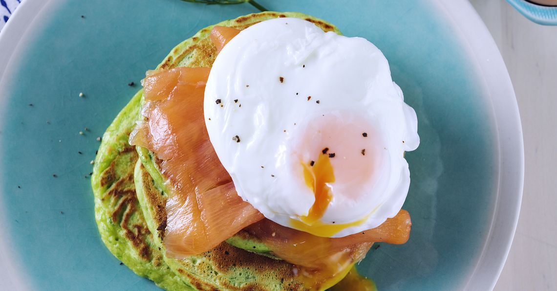 Spinach and dill pancakes with salmon and eggs
