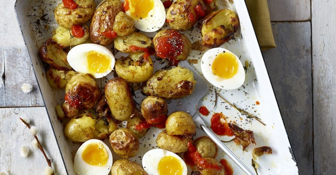 Crispy breakfast potatoes with soft boiled eggs
