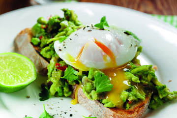 Eggs and guacamole on toast