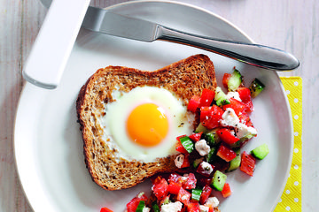 Egg in a toast with tomato and feta