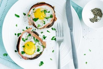 Baked eggs and ham in Portobello mushrooms