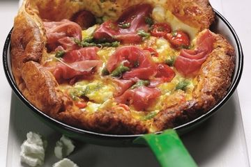 Savoury pancake puff with Parma ham, tomatoes, feta and pesto
