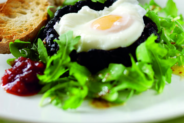 Black pudding with a poached egg
