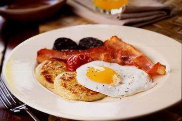 Pancakes with eggs, bacon, black pudding
