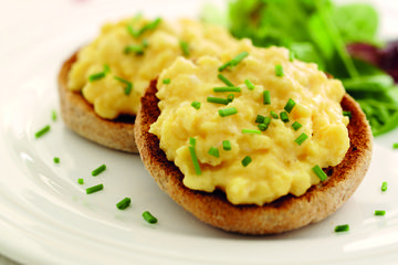 Scrambled eggs on toasted wholemeal muffins