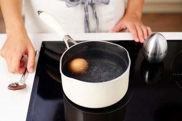 Boiled egg in saucepan